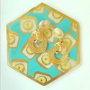 Gold circular earrings